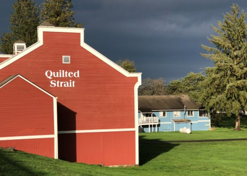 Stunning skies against the colorful Port Gamble buildings